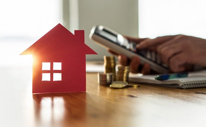 Buying And Selling Houses And Real Estate Prices Concept. Man Us